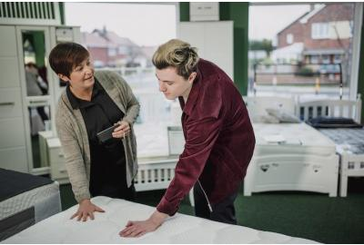Man Buying Mattress From Woman